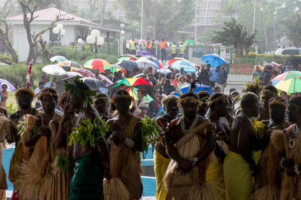 Throngs of people line up in the rain to pay their respects to Edward Natapei, whose body lies in state at Parliament.