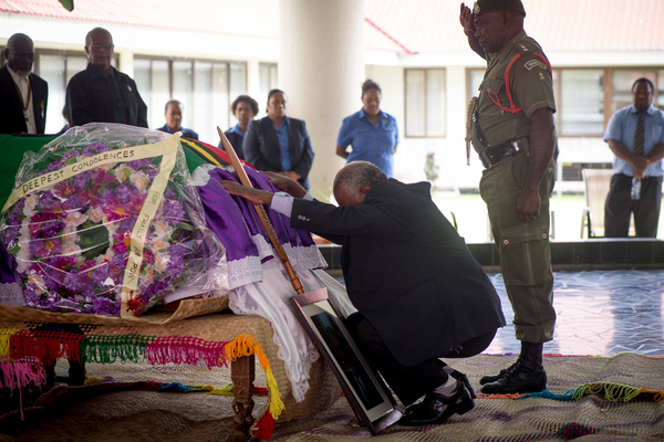 President Baldwin Lonsdale abases himself before the coffin of Edward Natapei as his body lies in state at Parliament.
