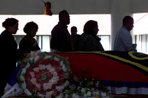 Mourners line up to pay their respects to the family.