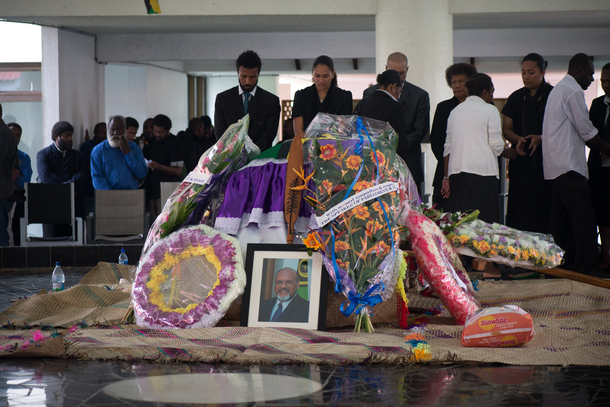 The coffin of Edward Natapei lies in state at Parliament.