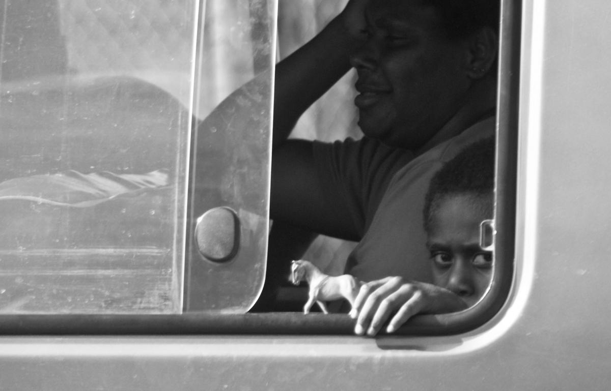 Playtime in transit on one of Port Vila's countless buses.