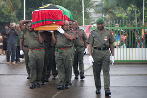 The body of President Baldwin Lonsdale is carried into Parliament by a Vanuato Mobile Force honour guard.