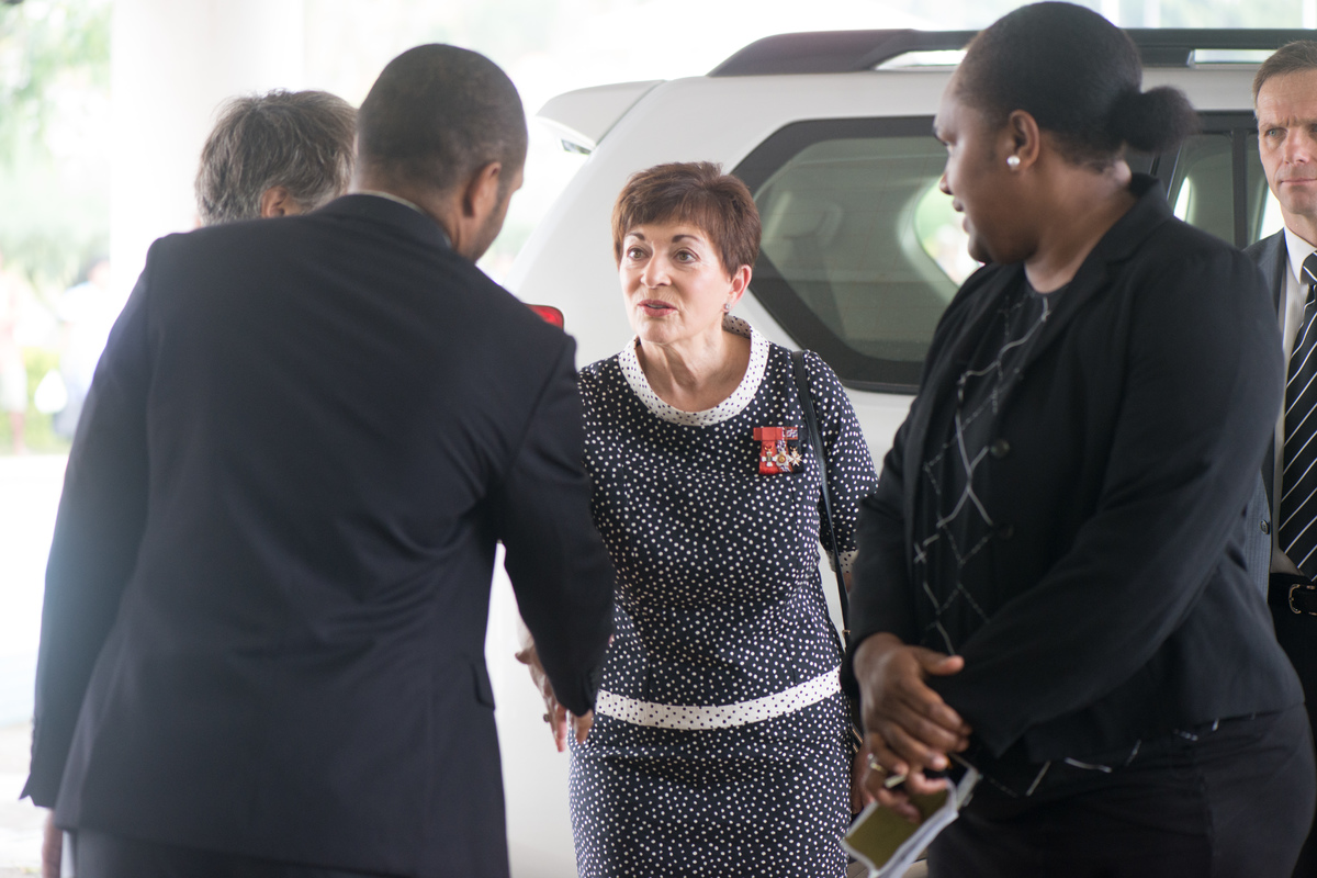 Governor General of New Zealand Dame Patsy Reddy is greeted by Foreign Affairs officials as she enters Vanuatu's Parliament to attend the state funeral of President Baldwin Lonsdale.
