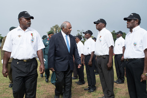 President Lonsdale inspects a contingent of retired colonial police officers.