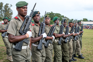 Vanuatu Mobile Force members turn eyes right as they march past the reviewing stand.