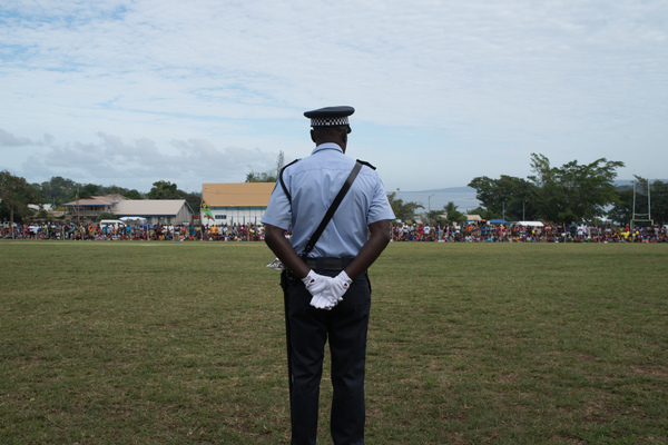 A policeman stands by as the crowd gathers to celebrate at Independence Park.