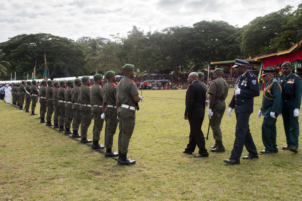 President Obed Tallis inspects the troops.