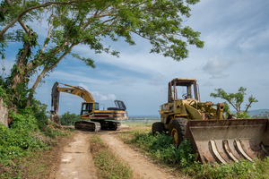 Construction equipment at the end of the road in Erangorango, overlooking the airport.