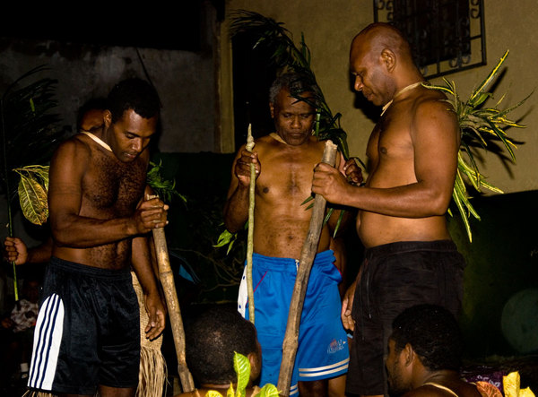 We had a farewell party for Tim yesterday, and Chief Caspar and some of his family from Mota Lava contributed by performing a kastom dance. These are some of the musicians. The light quality is terrible because my strobe lost its charge after the first shot.
