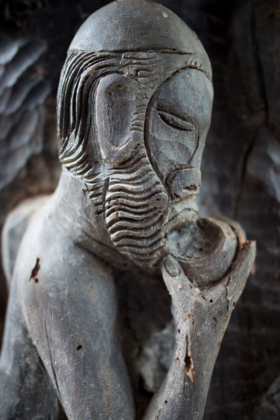 A beautiful carving of a kava drinker. Seen in a nakamal in Jump Street, Tagabe, Port Vila.