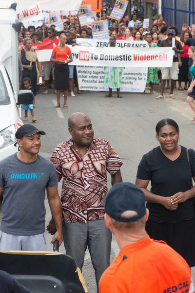 Justice Minister Ronald Warsal took his place at the head of a march to end violence against women.