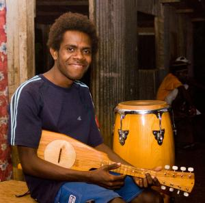 This young man plays with Tausake, one of the oldest and  most reputed string bands in Vanuatu.