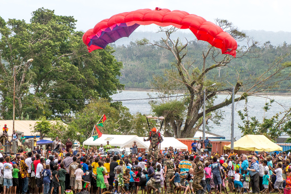A French Armed Forces sky diver falls short and lands in a crowd of spectators at celebrations marking Vanuatu's 35th anniversary of independence.