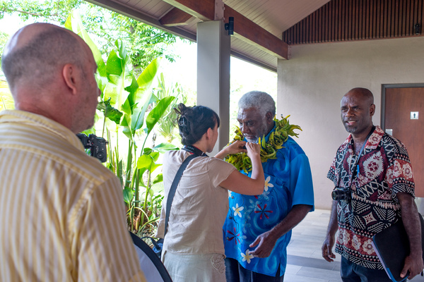 Prime Minister Joe Natuman at the opening ceremony of Pacific ICT Days 2015. Here, he is preparing for an interview the a Canadian documentary film crew.