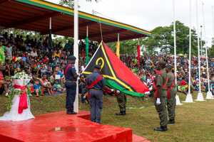 The colour guard raises Vanuatu's flag during celebrations marking the 35th anniversary of independence in Port Vila.