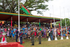 The colour guard raises Vanuatu's flag during celebrations marking the 35th anniversary of independence in Port Vila. The flag was raised, then lowered to half-staff to mark the passing of Edward Natapei just two days earlier.