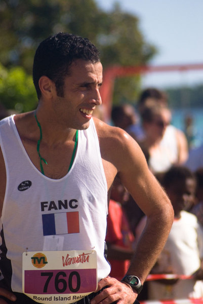 One of the members of the 2nd place team in this year's Round Island Relay. The French military detachment in  New Caledonia are annual competitors, but they've been beaten for the last three consecutive years by local teams from  Tanna Island. The Round Island Relay is a foot race that follows Efate's ring road on its 140 kilometre course around the island. There are some significant hills, and the road conditions on the majority of the course are often terrible. To add to their achievement, many of the local teams are too poor to buy proper running shoes, so they run their 13-16 km intervals barefoot.