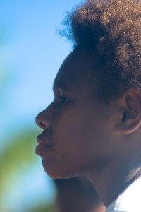 A young girl watches the show at Port Vila's Seafront Stage.