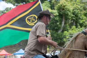 Marco Traverso carries the flag to open the 2017 edition of the Port Vila Rodeo.