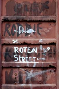 Graffiti on the door of a shipping container in Pango.