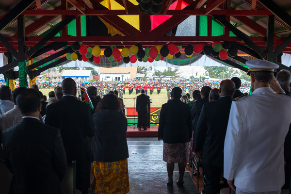 Prime Minister of Vanuatu Sato Kilman reviews the troops as rain falls on Vanuatu's 35 independence day celebrations.