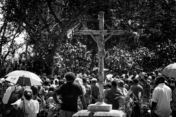 Shots from the burial of a Catholic priest in Montmartre cemetery.