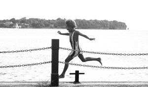 A young girl playing at Port Vila's Seafront.