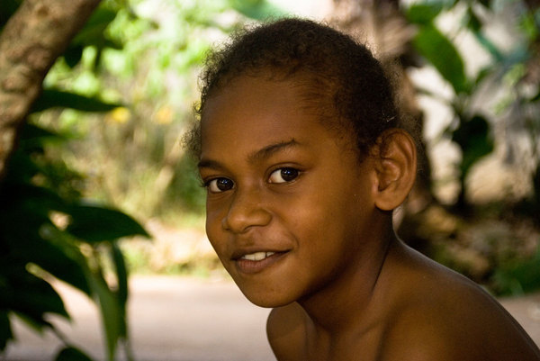 A young boy in the Seven Star neighbourhood in Port Vila. A boy's first  hair cut is a special occasion, requiring the participation of all of his uncles. The cost in pigs and food can be quite high for some, so it's not at all unusual to see a boy with his hair back in a pony tail.
