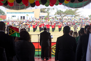 Vanuatu President Baldwin Lonsdale stands as the Vanuatu Mobile Force band plays the national anthem during celebrations marking 35 years of independence.