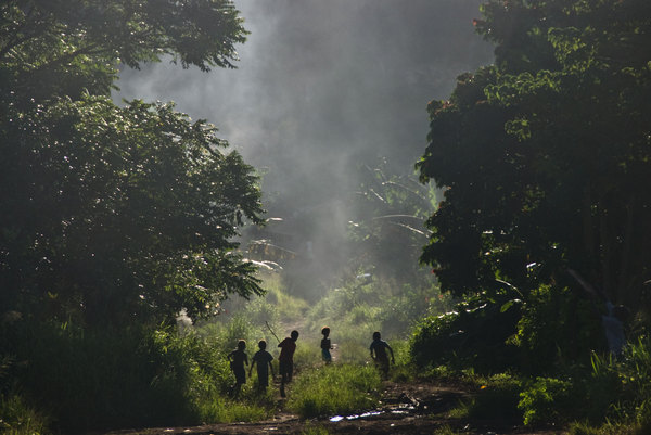 Smoke from a cookfire billows out over a residential road in Port Vila's Freswota 4 neighbourhood.