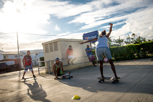 The Vanuatu National Surfing team does a little dry-land training. Boucherie Furet very kindly allowed its parking lot to be repurposed for a day as a dry-land training ground. The team members used specially crafted skateboards designed to mimic a surfboard's feel as the trainees run the slalom course. The team, aged between 10 and 35 years old, will compete in the Melanesian Cup next month in Noumea.