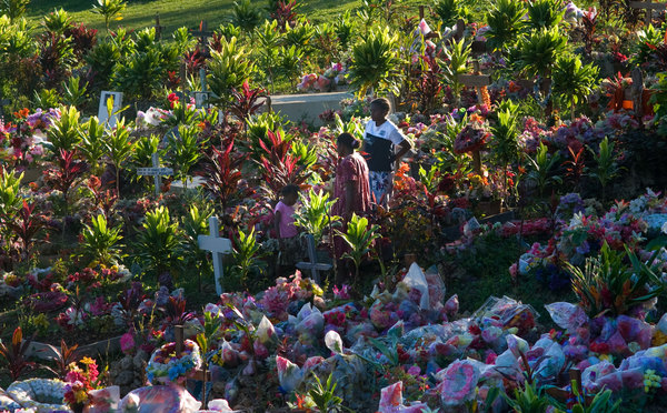 In stark contrast to most North American or European cemetaries, Port Vila's public burial ground is resplendent with colour. Graves are tended carefully by family members for years after someone's passing.