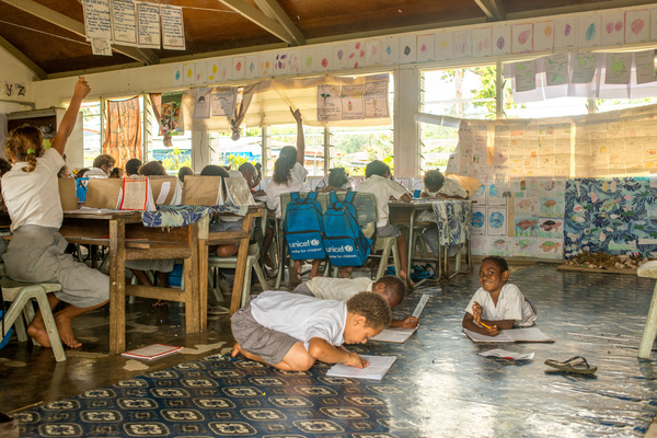 Students from Vila North school in Port Vila work using materials provided by UNICEF, whose extensive support has made it possible for Vila North to continue providing an education for hundreds of children.