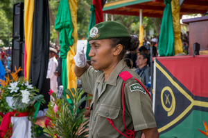 A member of the Vanuatu Mobile Force salutes passing comrades at the reviewing stand at Vanuatu's 35th independence anniversary celebrations.