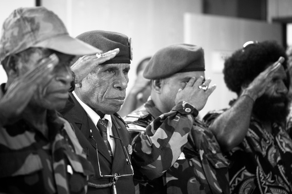 Members of the West Papuan resistance salute the Prime Minister of Vanuatu during his meeting with the ULMWP.